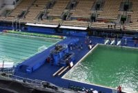 A picture taken on August 10, 2016 at the Maria Lenk Aquatics Stadium in Rio de Janeiro shows the Water Polo (L) pool and the diving pool of the Rio 2016 Olympic Games.   Red-faced Rio Olympics organisers anxiously waited for the diving water to turn back from a nervy green to classic blue as a lack of chemicals was revealed as the cause of the colour changes. Heavy rain slowed the flow of new chemicals added to the water which was also green in the pool used for the synchronised swimming and water-polo.  / AFP / CHRISTOPHE SIMON        (Photo credit should read CHRISTOPHE SIMON/AFP/Getty Images)