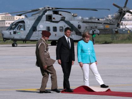 Italian Prime Minister Matteo Renzi (C), German Chancellor Angela Merkel