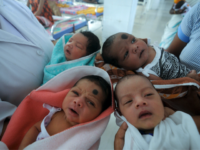 Indian nurses care for newly born babies at the maternity ward of a hospital on the eve of World Population Day, in Guwahati on July 10, 2014. World Population Day, which was established by the United Nations Development Programme in 1989 and is observed annually, seeks to raise awareness of …