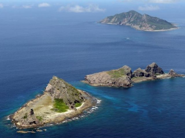File photo taken in September 2012 shows (from front) Minamikojima, Kitakojima and Uotsuri islands of the Senkaku Islands in the East China Sea. The Chinese army is weighing the full use of unmanned aircraft to regularly monitor the East China Sea, a move that may add fuel to heightened tension …