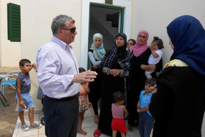 Nampil-iosif Morant, the Syrian-born mayor of the local Andravida-Kyllini municipality, meets Syrian refugees in a former Peloponnese tourist resort that has been turned into a migrant home near the town of Myrsini southwest of Athens, Greece, August 13, 2016. REUTERS/Michele Kambas