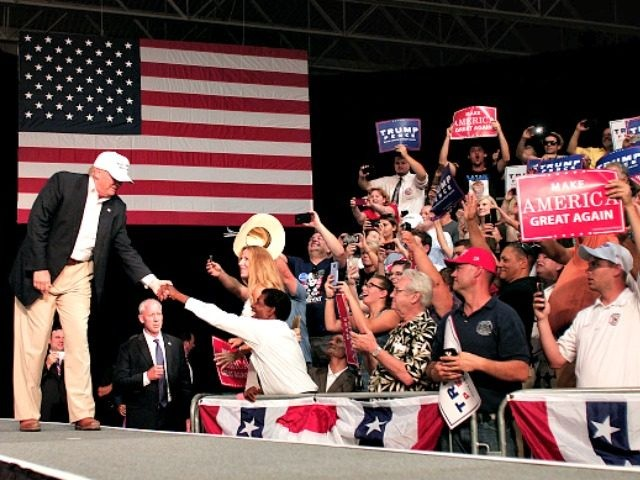 DIMONDALE, MI - AUGUST 19: Republican presidential nominee Donald Trump shakes hands with supporters on his way to the podium to speak at a campaign rally August 19, 2016 in Dimondale, Michigan. Earlier in the day, Trump toured flood-ravaged Louisiana. (Photo by Bill Pugliano/Getty Images) *** TRUMP ***