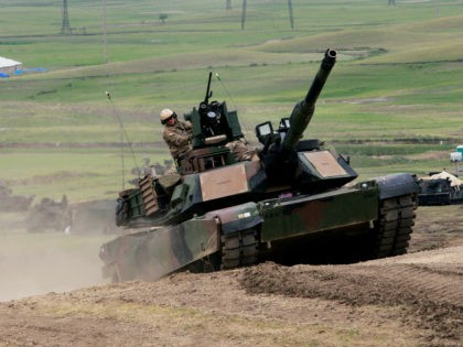 U.S. M1A2 Abrams tank moves to firing positions during joint military exercises at the Vaziani military base outside Tbilisi, Georgia, Wednesday, May 18, 2016. About 1,300 U.S., British and Georgian troops conducted joint exercises aimed at training the former Soviet republic's military for participation in the NATO Response Force. (AP …