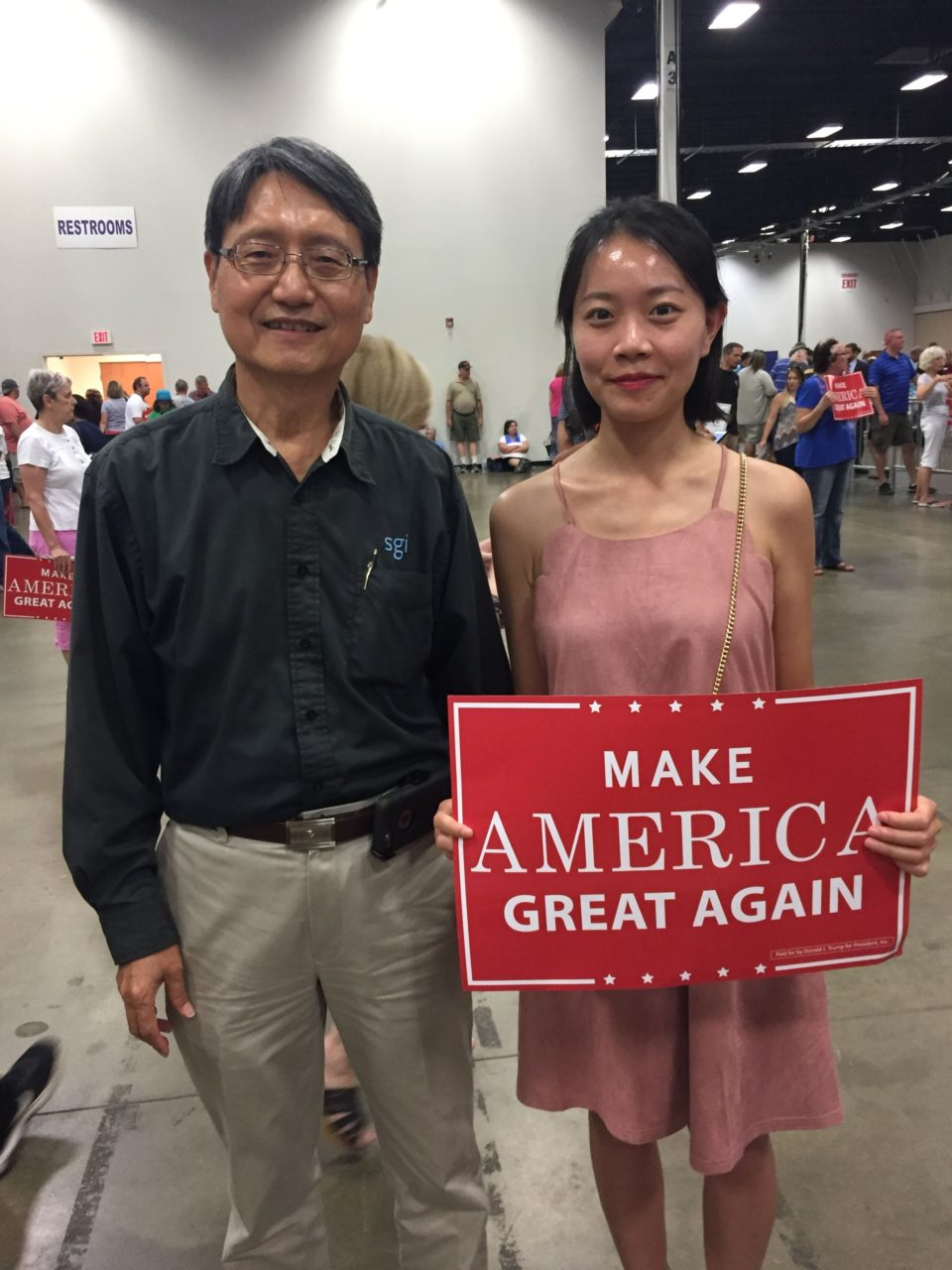 Man and his daughter at rally