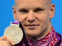 Russia's Evgeny Korotyshkin poses on the podium with his medal after winning silver in the men's 100m butterfly final swimming event at the London 2012 Olympic Games on August 3, 2012 in London. AFP PHOTO / MARTIN BUREAU (Photo credit should read MARTIN BUREAU/AFP/GettyImages)