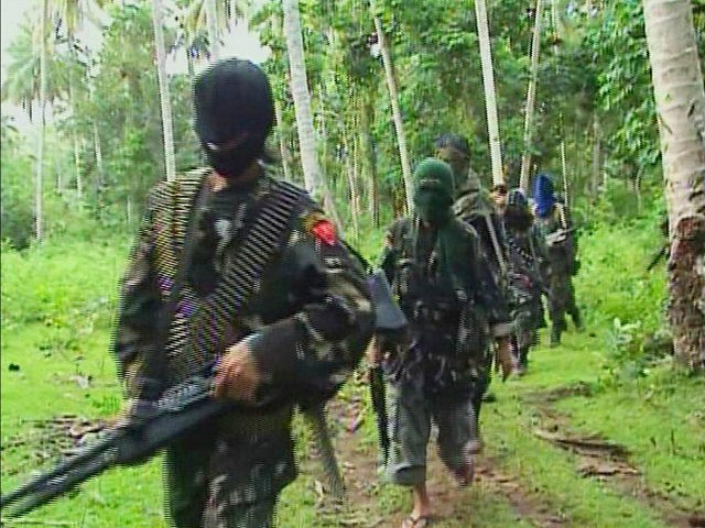 Abu Sayyaf rebels are seen in the Philippines in this video grab made available February 6, 2009. REUTERS/Philippine National Red Cross via Reuters TV