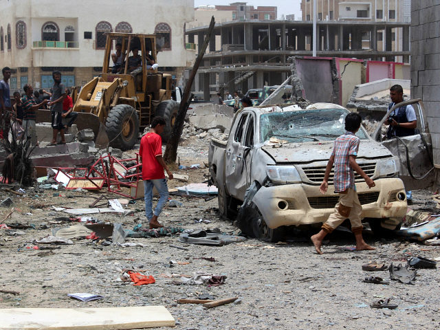 YEMEN, Aden : Yemenis inspect the site of a suicide car bombing claimed by the Islamic State group on August 29, 2016 at an army recruitment centre in the southern Yemeni city of Aden. Yemeni security officials told AFP that the attacker drove an explosives-laden vehicle into a gathering of …