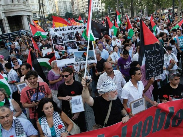 DEMONSTRATORS MARCH with Palestinian flags during a protest against the Israeli offensive against Gaza, in Valencia, Spain. (photo credit:REUTERS)