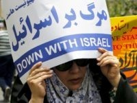 An Iranian woman holds an anti-Israeli slogan during a parade marking al-Quds (Jerusalem) Day in Tehran on July 01, 2016. Tens of thousands joined pro-Palestinian rallies in Tehran, as the annual Quds Day protests take on broader meaning for a region mired in bitter disputes and war. / AFP / ATTA KENARE (Photo credit should read ATTA KENARE/AFP/Getty Images)