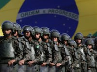 FILE - In this July 22, 2016 photo, Brazilian Army soldiers take part in military exercise during presentation of the security forces for the Rio 2016 Olympic Games, in front of the National Stadium, in Brasilia, Brazil. Security has emerged as the top concern during the Olympics, including violence possibly …
