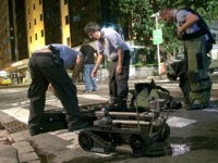 An image taken on a mobile phone shows members of Brazil's security services as they pack away bomb disposal equipment following a controlled explosion in the Copacabana district of Rio de Janeiro on August 9, 2016. A suspect package was blown up on Tuesday near the luxury beachfront Copacabana Palace hotel. Earlier in the day a bus carrying Rio Olympics journalists came under attack and police were investigating whether bullets were fired from the notorious City of God favela. / AFP / Leon NEAL (Photo credit should read LEON NEAL/AFP/Getty Images)