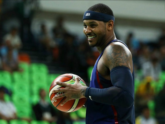 RIO DE JANEIRO, BRAZIL - AUGUST 06: Carmelo Anthony #15 of United States reacts during the game against the China in the Men's Preliminary Round Group A match on Day 1 of the Rio 2016 Olympic Games at Carioca Arena 1 on August 6, 2016 in Rio de Janeiro, Brazil. …