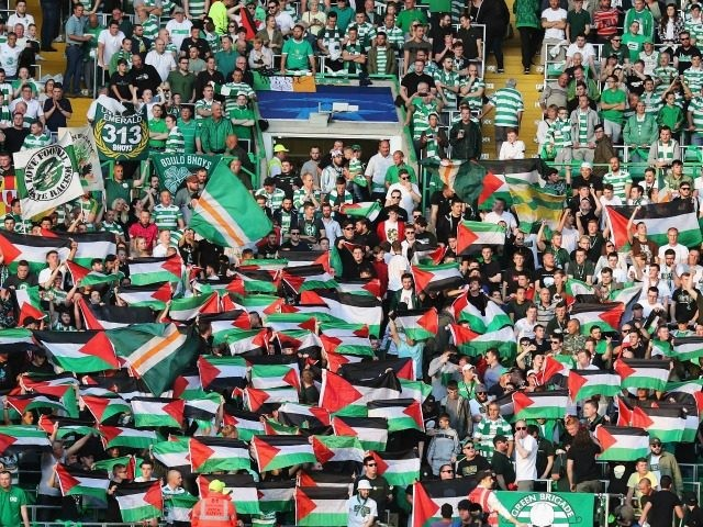 Palestinian flags are waved by fans during the UEFA Champions League Play-off First leg match between Celtic and Hapoel Beer-Sheva at Celtic Park on August 17, 2016 in Glasgow, Scotland. (Photo by Steve Welsh/Getty Images)