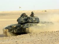 The battle tank Challenger 2 of the 3rd Troop ''D'' Squadron of the Royal Dragoon Guards (RDG) ploughs through the sand September 25, 2001 north of Thumbrait, Oman. The squadron is taking part in exercise Saif Sareea II, a bi-lateral military exercise in Oman in which more than 20,000 troops have been deployed from Britain and Germany to train alongside Omani forces in a variety of roles. (Photo by Pete Bristo/British Army/Getty Images)