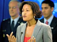 State Department Counselor Cheryl Mills, center, gestures during a news conference at the State Department in Washington, Wednesday, Jan. 13, 2010. She is joined by US SOUTHCOM Gen. Douglas Fraser, left, and United States Agency for International Development (USAID) Administrator Rajiv Shah. (AP Photo/Kevin Wolf)
