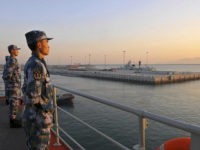 Chinese naval soldiers stand guard on China's first aircraft carrier Liaoning, as it travels towards a military base in Sanya, Hainan province, in this undated picture made available on November 30, 2013. REUTERS/Stringer Chinese naval soldiers stand guard on China's first aircraft carrier Liaoning, as it travels towards a military …