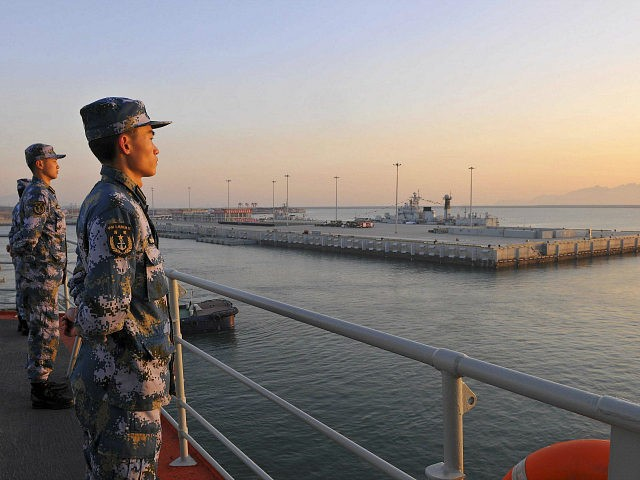 Chinese naval soldiers stand guard on China's first aircraft carrier Liaoning, as it travels towards a military base in Sanya, Hainan province, in this undated picture made available on November 30, 2013. REUTERS/Stringer Chinese naval soldiers stand guard on China's first aircraft carrier Liaoning, as it travels towards a military base in Sanya, Hainan province, in this undated picture made available on November 30, 2013. REUTERS/STRINGER