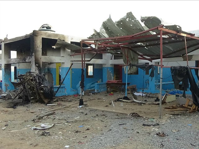 A hospital supported by Doctors Without Borders is seen after was hit by a Saudi-led airstrike in the northern town of Abs, Yemen, Tuesday, Aug.16, 2016. Yemen's Houthi rebels condemned the Saudi-led military coalition on Tuesday over an airstrike that hit a hospital, killing several people. (AP Photo)