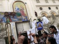 Egyptian Christians protest outside the Al-Qiddissine (The Saints) church following an overnight car bomb attack on the church in the Egyptian port city of Alexandria on January 1, 2011 which killed 21 people, hitting Egypt's Christian community, the biggest in the Middle East. AFP PHOTO/MOHAMMED ABED (Photo credit should read …