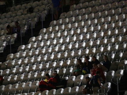 RIO DE JANEIRO, BRAZIL - AUGUST 08: People watch a match amongst empty seats at the Olympic beach volleyball stadium at Copacabana beach during the Rio 2016 Olympic Games on August 8, 2016 in Rio de Janeiro, Brazil. Around 82 percent of tickets to the games have been sold so …