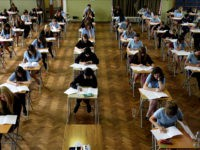 Sats test results for 11-year-olds due out.File photo dated 11/06/08 of pupils sitting an exam. Results of national curriculum tests taken by England's 11-year-olds will be published today. Issue date: Tuesday August 4, 2009. They will show how well pupils are performing in English, maths and science. The Liberal Democrats predicted the results would reveal that more than half a million children have left primary school unable to read or write since Labour came to power in 1997. See PA story EDUCATION Sats. Photo credit should read: Chris Radburn/PA Wire URN:7666034 (Press Association via AP Images)