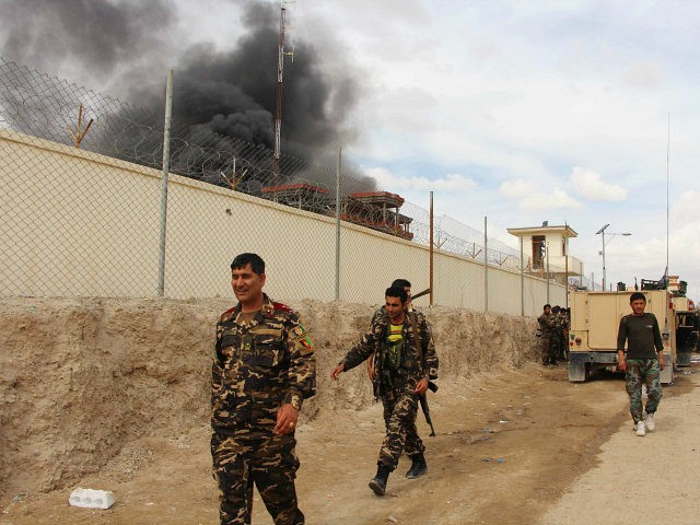 FILE -- In this March 9, 2016 file photo, smoke rises from a building, where Taliban insurgents hide during a fire fight with Afghan security forces, in Helmand province, south west Afghanistan. Kareem Atal, head of the provincial council, said Wednesday, Aug. 10, 2016, that troops are being deployed to a key southern city in Helmand province where fighting is raging with the Taliban to ensure it does not fall to the insurgents. Helmand is a strategically important province for both the Kabul government and the Taliban, whose insurgency is now in its 15th year. (AP Photo, File)