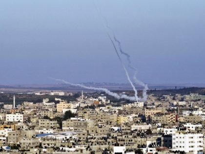 Smoke trails mark the path of Palestinian missiles fired from the north-east of Gaza City on August 21, 2014. As the sixth week war between Israel and Hamas raged on, leaving Egyptian mediated truce talks in tatters, warplanes continued to pound Gaza killing three members of the Islamist movement's armed …