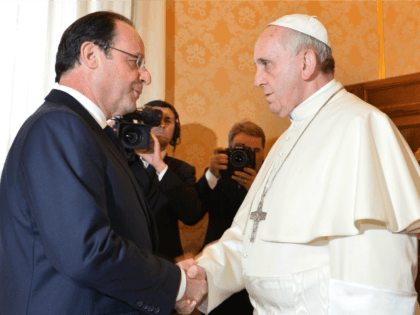 France's President Francois Hollande (L) meets with Pope Francis during a private audience on January 24, 2014 at the Vatican. AFP PHOTO POOL / GABRIEL BOUYS (Photo credit should read GABRIEL BOUYS/AFP/Getty Images)