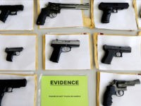 FILE-In this July 7, 2014 file photo, Chicago police display some of the thousands of illegal firearms they confiscated during the year in their battle against gun violence in Chicago. Hoping to stem the flow of illegal guns into Illinois, lawmakers have sent Republican Gov. Bruce Rauner legislation that would …