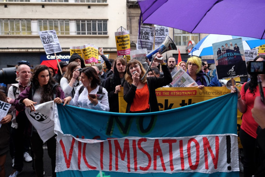 Protesters chant pro-migrant slogans