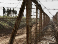 Border Security Force or BSF soldiers patrol an area where a 30-meter (98-foot) long tunnel was found in R.S. Pura sector at India-Pakistan border 35 kilometers (22 miles) from Jammu, India, Friday, March 4, 2016. The tunnel was allegedly dug from the Pakistani side to push arms and terrorists into …