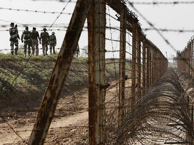Border Security Force or BSF soldiers patrol an area where a 30-meter (98-foot) long tunnel was found in R.S. Pura sector at India-Pakistan border 35 kilometers (22 miles) from Jammu, India, Friday, March 4, 2016. The tunnel was allegedly dug from the Pakistani side to push arms and terrorists into Jammu city, said BSF Inspector Gen. Rakesh Sharma. (AP Photo/ Channi Anand)
