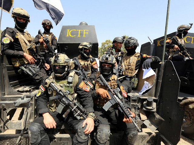 "IRAQ, Baghdad : Members of the ""Golden Division"", the special forces of the Iraqi counter-terrorism forces (ICTF), take part in a training under the command of international military instructors in Baghdad on March 20, 2016, as they preparare for a future operation aimed at retaking the northern city of Mosul, …"