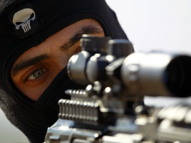 A fighter from the Iraqi Imam Ali Brigade, take part in a training exercise in Iraq's central city of Najaf on March 7, 2015, ahead of joining the military operation in the city of Tikrit. Some 30,000 Iraqi security forces members and allied fighters launched an operation to retake Tikrit …