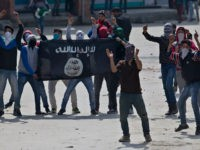 Kashmir Muslim protesters hold a flag of Islamic State as they shout anti-India slogans during a protest in Srinagar, Indian controlled Kashmir, Friday, April 8, 2016. Police fired teargas and pellet guns to disperse Kashmiris who gathered after Friday afternoon prayers to protest against Indian control over a part of …