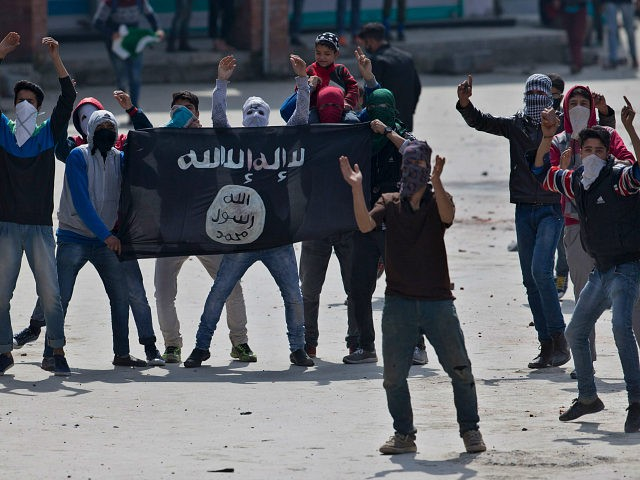Kashmir Muslim protesters hold a flag of Islamic State as they shout anti-India slogans during a protest in Srinagar, Indian controlled Kashmir, Friday, April 8, 2016. Police fired teargas and pellet guns to disperse Kashmiris who gathered after Friday afternoon prayers to protest against Indian control over a part of the disputed region of Kashmir. (AP Photo/Dar Yasin)