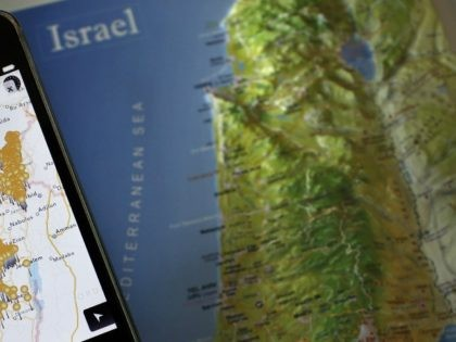 A photo taken on May 5, 2014 shows a smartphone placed on an Israeli map in Jerusalem, displaying the new application developed by Israeli non-governmental organization (NGO), Zochrot, called 'Inakba' that allows users to find the remains of Palestinian villages that now lie inside modern-day Israel.