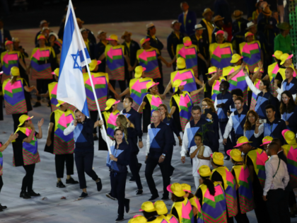 RIO DE JANEIRO, BRAZIL - AUGUST 05: Neta Rivkin of Israel carries the flag during the Opening Ceremony of the Rio 2016 Olympic Games at Maracana Stadium on August 5, 2016 in Rio de Janeiro, Brazil. (Photo by Clive Brunskill/Getty Images)