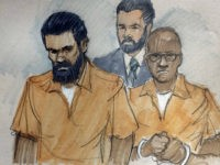 \FILE - In this March 26, 2015 file courtroom sketch, Jonas Edmonds, left, and his cousin Hasan Edmonds, right, stand in front of an FBI agent as they appear at a hearing at federal court in Chicago following their arrests on charges of conspiring with the Islamic State group. Prosecutors say the two plotted to carry out a terrorist attack in the United States. Jonas Edmonds is scheduled to be sentenced on Wednesday, Jan. 27, 2016 in Chicago. His cousin, Hasan, pleaded guilty to similar counts. He will be sentenced later. (AP Photo/Tom Gianni, File)