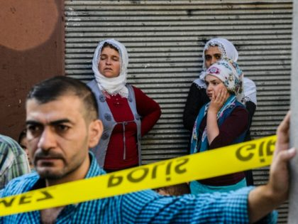 People stand near the explosion scene following a late night attack on a wedding party that left at least 30 dead in Gaziantep in southeastern Turkey near the Syrian border on August 21, 2016. Turkish President Recep Tayyip Erdogan on Sunday said the Islamic State (IS) group was the 'likely …