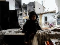 A child sits in front of the wreckage of a blast damaged building on January 14, 2016 in Diyarbakir. Six people died and 39 others were wounded in a car bomb attack blamed on Kurdish rebels that ripped through a police station and an adjacent housing complex for officers and their families in southeastern Turkey, security forces said on January 14, 2016 updating an earlier toll of five. / AFP / ILYAS AKENGIN (Photo credit should read ILYAS AKENGIN/AFP/Getty Images)