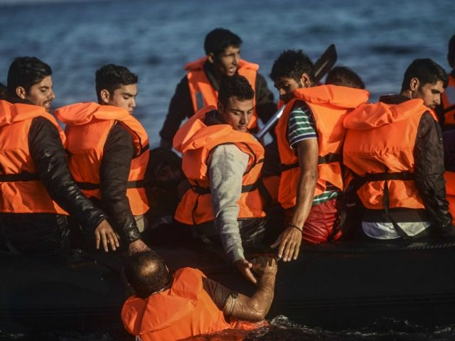 Migrants and refugees embark on a raft to the Greek island of Chios from Cesme in the Turkish province of Izmir on November 5, 2015. Up to 600,000 migrants and refugees are expected to cross from Turkey to Greece and onwards over the next four months, the UN said Novewmber …