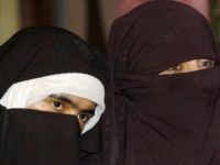 Veiled Indian Kashmiri Muslim activists of the Dukhtaran-e-Milat (Daughters of the Faith) organization look on during a press confrence held to urge the government to reveal the names of people caught up in a prostitution scandal in Srinagar, 10 May 2006. Police in April 2006 unearthed an alleged racket involving …