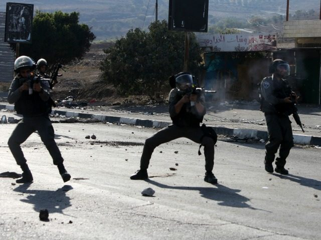 Israeli border guards take aim at Palestinian demonstrators (unseen) during clashes at the Hawara checkpoint, south of the West Bank city of Nablus on October 16, 2015. Palestinians called for a 'Friday of revolution' against Israel, as Jews armed themselves with everything from guns to broomsticks, rattled by a wave …