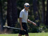 President Barack Obama smiles after putting on the first green during a round of golf at Farm Neck Golf Course in Oak Bluffs, Mass., on Martha's Vineyard, Sunday, Aug. 7, 2016. The president and his family are vacationing in the Massachusetts island of Martha's Vineyard. (AP Photo/Manuel Balce Ceneta)