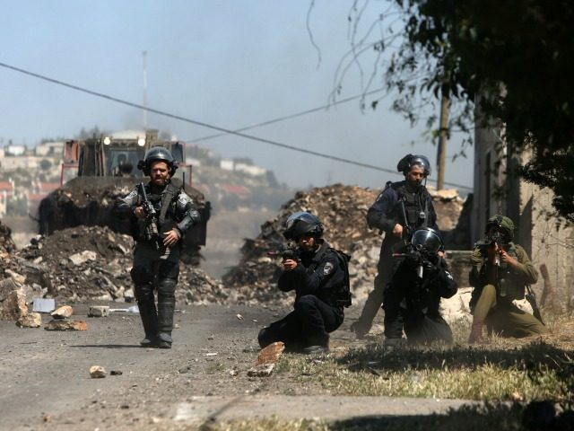 Israeli security forces aim at Palestinian protesters during clashes following a demonstration against the expropriation of Palestinian land by Israel on April 29, 2016 in the village of Kfar Qaddum, near Nablus, in the occupied West Bank. / AFP / JAAFAR ASHTIYEH (Photo credit should read JAAFAR ASHTIYEH/AFP/Getty Images)