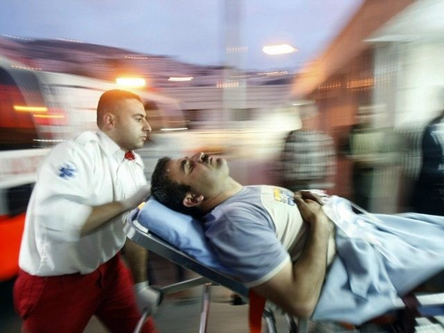 A Palestinian paramedic wheels a wounded man into the emergency ward of a hospital in the northern West Bank city of Nablus, following a shooting spree by Jewish settlers on Palestinian villagers in the nearby village of Ourif on April 24, 2009. Israeli settlers opened fire and wounded seven Palestinians, …
