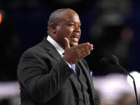 Pastor Mark Burns delivers the benediction at the close of the afternoon session during the opening day of the Republican National Convention in Cleveland, Monday, July 18, 2016. (AP Photo/Mark J. Terrill)