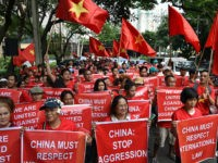Filipino and Vietnamese protesters display anti-China placards and Vietnamese national flags during a call on China to respect their rights in the disputed South China Sea, in front of the Chinese consular office in Manila on August 6, 2016. The Philippines told its fishermen on August 3 to steer clear …
