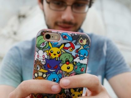 A player's phone is decorated with Pokemon stickers as he plays Pokemon Go, a mobile game that has become a global phenomenon, the day after it's UK release on July 15, 2016 in London, England. The app lets players roam using their phone's GPS location data and catch Pokemon to …